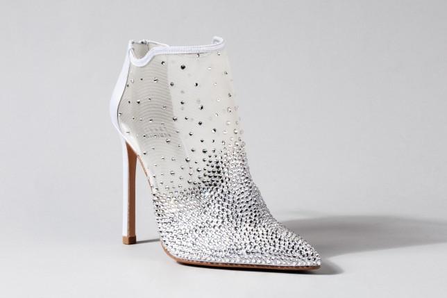 e439d19e3e2e Designers including Jimmy Choo and Louboutin have created Cinderella s  glass slipper